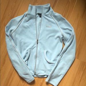 BEBE Sz Md light blue zip up fleece jacket